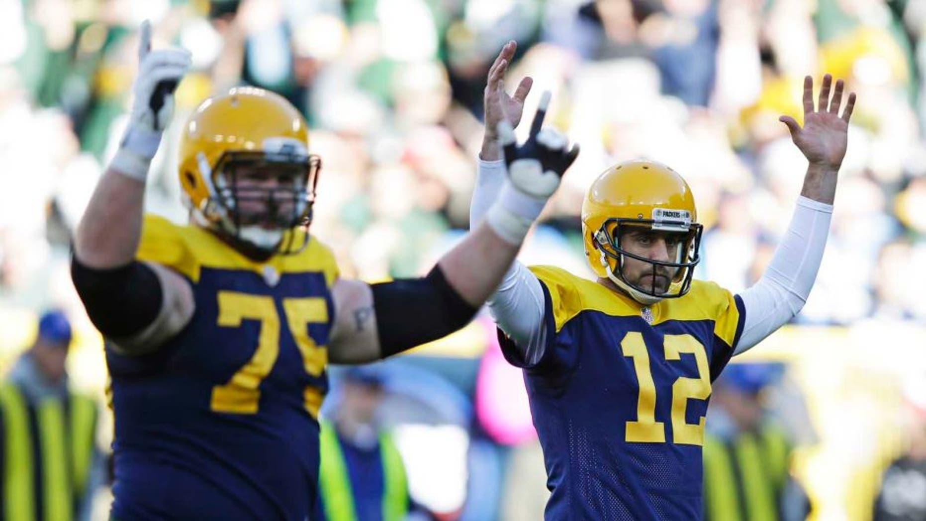 Green Bay Packers quarterback Aaron Rodgers (right) and Bryan Bulaga signal a touchdown after Rodgers threw a five-yard touchdown pass to James Starks during the first half against the San Diego Chargers on Sunday, Oct. 18, 2015, in Green Bay, Wis.