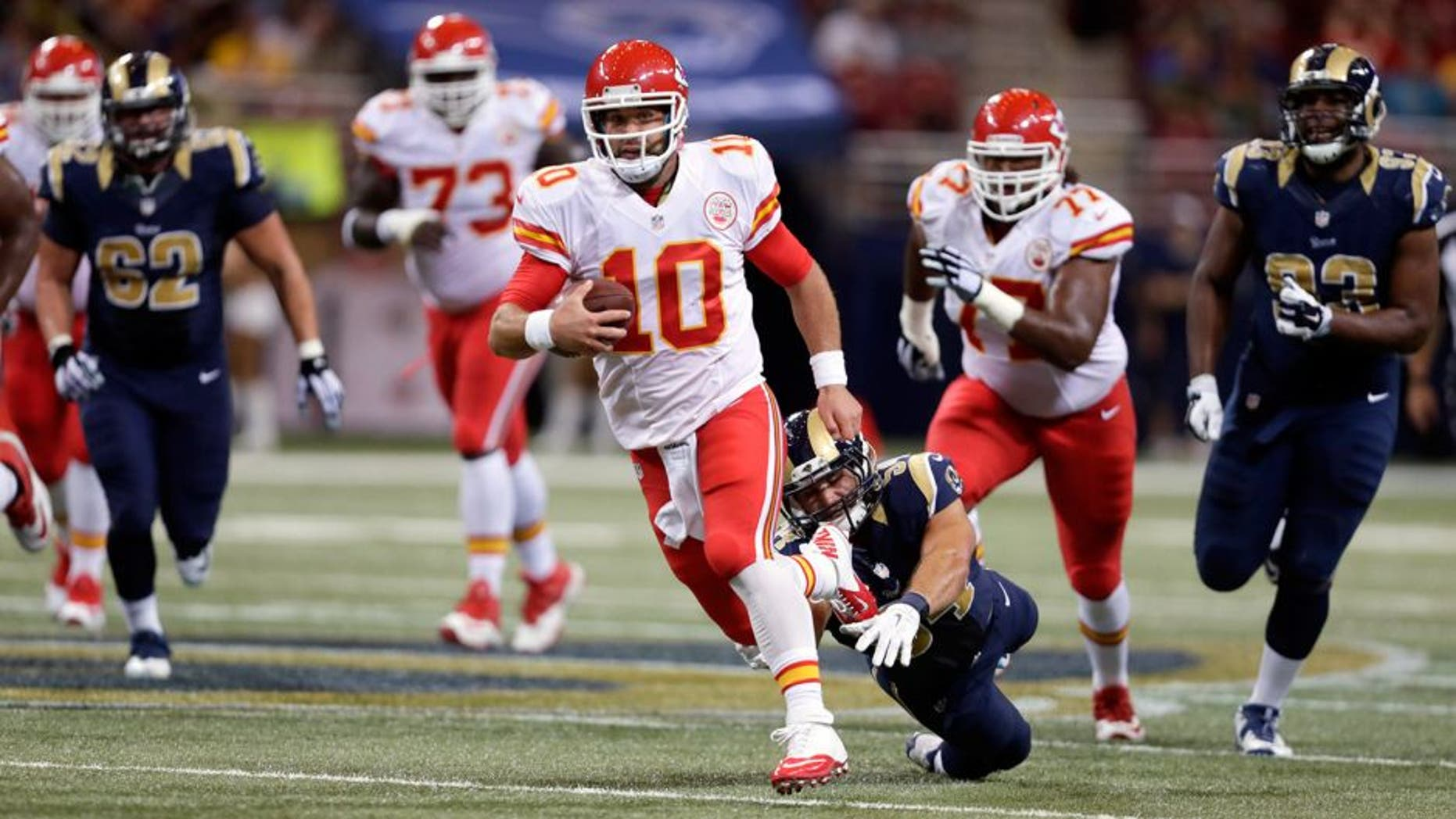 Kansas City Chiefs quarterback Chase Daniel scrambles for a 14-yard gain during the second quarter of an NFL preseason football game against the St. Louis Rams Thursday, Sept. 3, 2015, in St. Louis. (AP Photo/Tom Gannam)