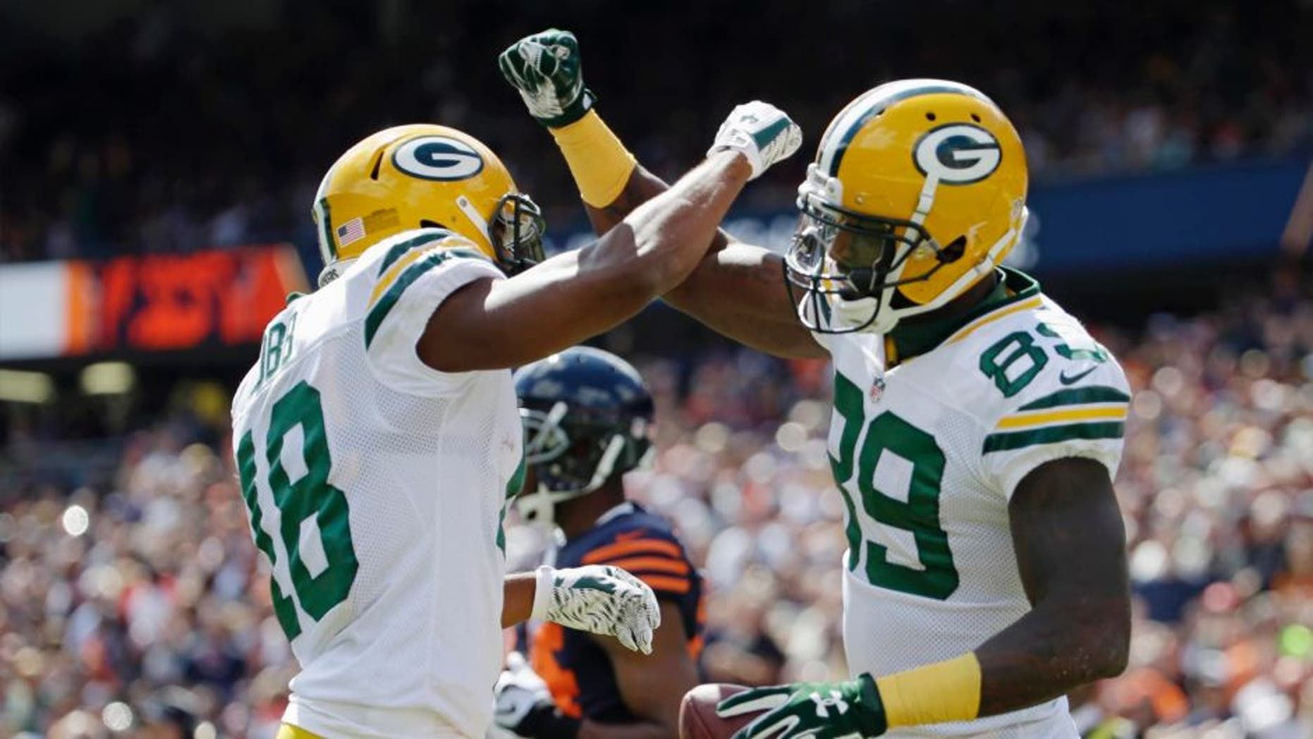 Green Bay Packers wide receiver James Jones (right) celebrates his touchdown reception with wide receiver Randall Cobb during the first half of an NFL football game, Sunday, Sept. 13, 2015, in Chicago.