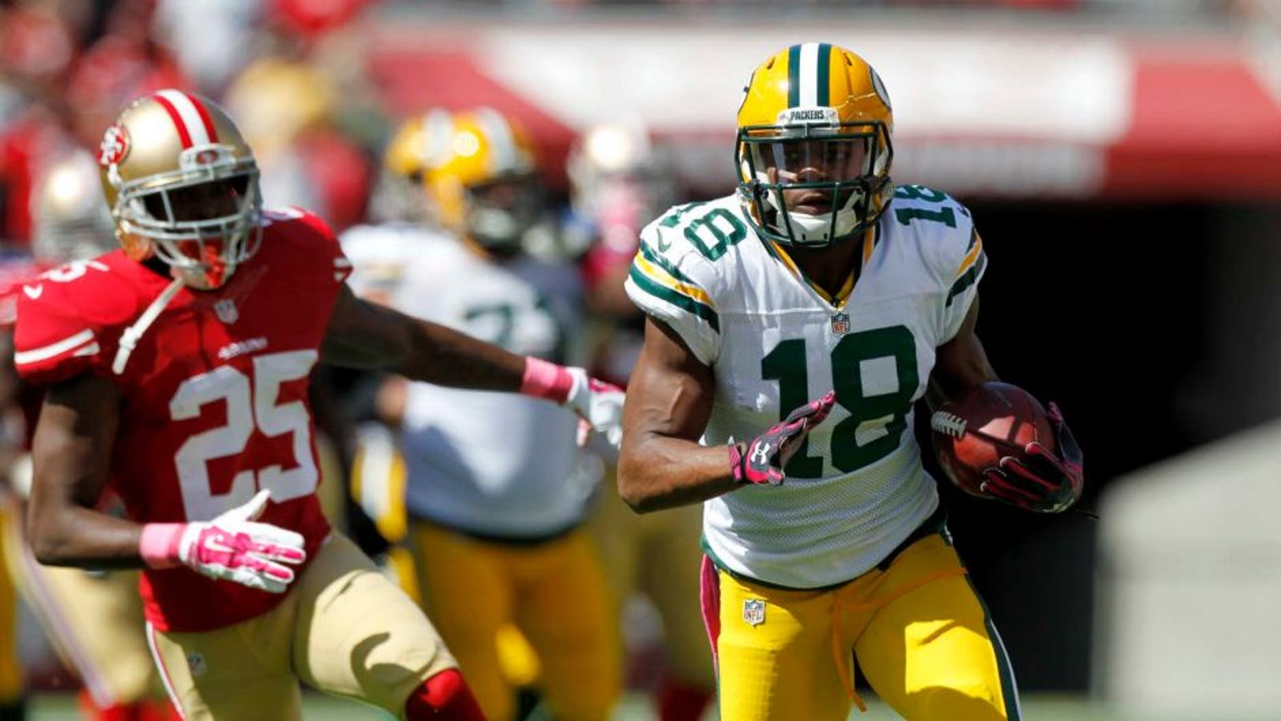Green Bay Packers wide receiver Randall Cobb runs with the ball after making a catch against the San Francisco 49ers in the first quarter at Levi's Stadium in Santa Clara, Calif., on Sunday, Oct. 4, 2015.