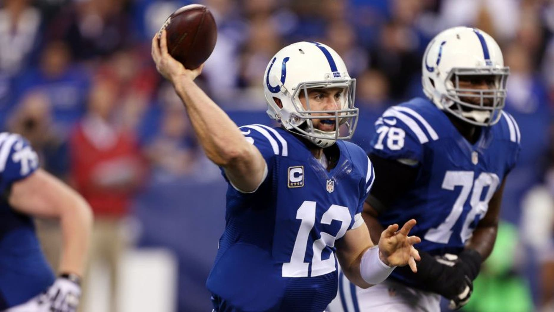Dec 14, 2014; Indianapolis, IN, USA; Indianapolis Colts quarterback Andrew Luck (12) throws a pass against the Houston Texans at Lucas Oil Stadium. Mandatory Credit: Brian Spurlock-USA TODAY Sports
