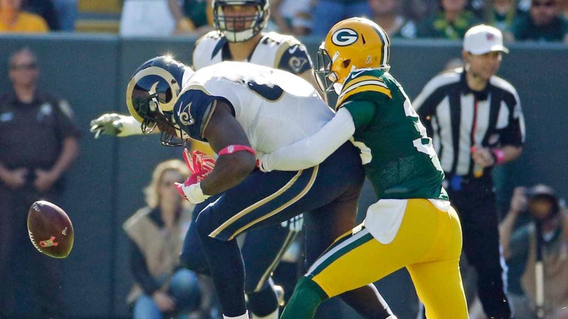 The Green Bay Packers' Micah Hyde breaks up a pass intended for the St. Louis Rams' Jared Cook during the first half Sunday, Oct. 11, 2015, in Green Bay, Wis.