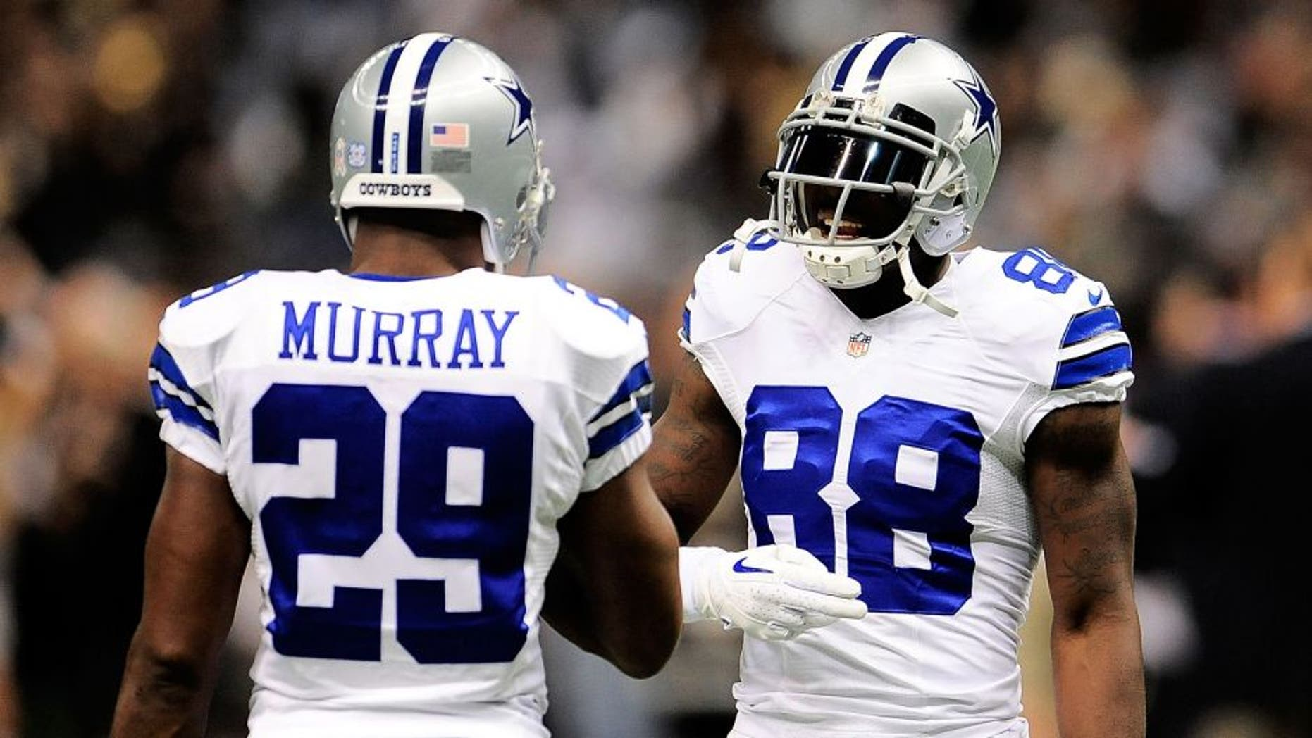 NEW ORLEANS, LA - NOVEMBER 10: DeMarco Murray #29 and Dez Bryant #88 of the Dallas Cowboys meet on the field prior to a game against the New Orleans Saints at the Mercedes-Benz Superdome on November 10, 2013 in New Orleans, Louisiana. New Orleans defeated Dallas 49-17. (Photo by Stacy Revere/Getty Images)