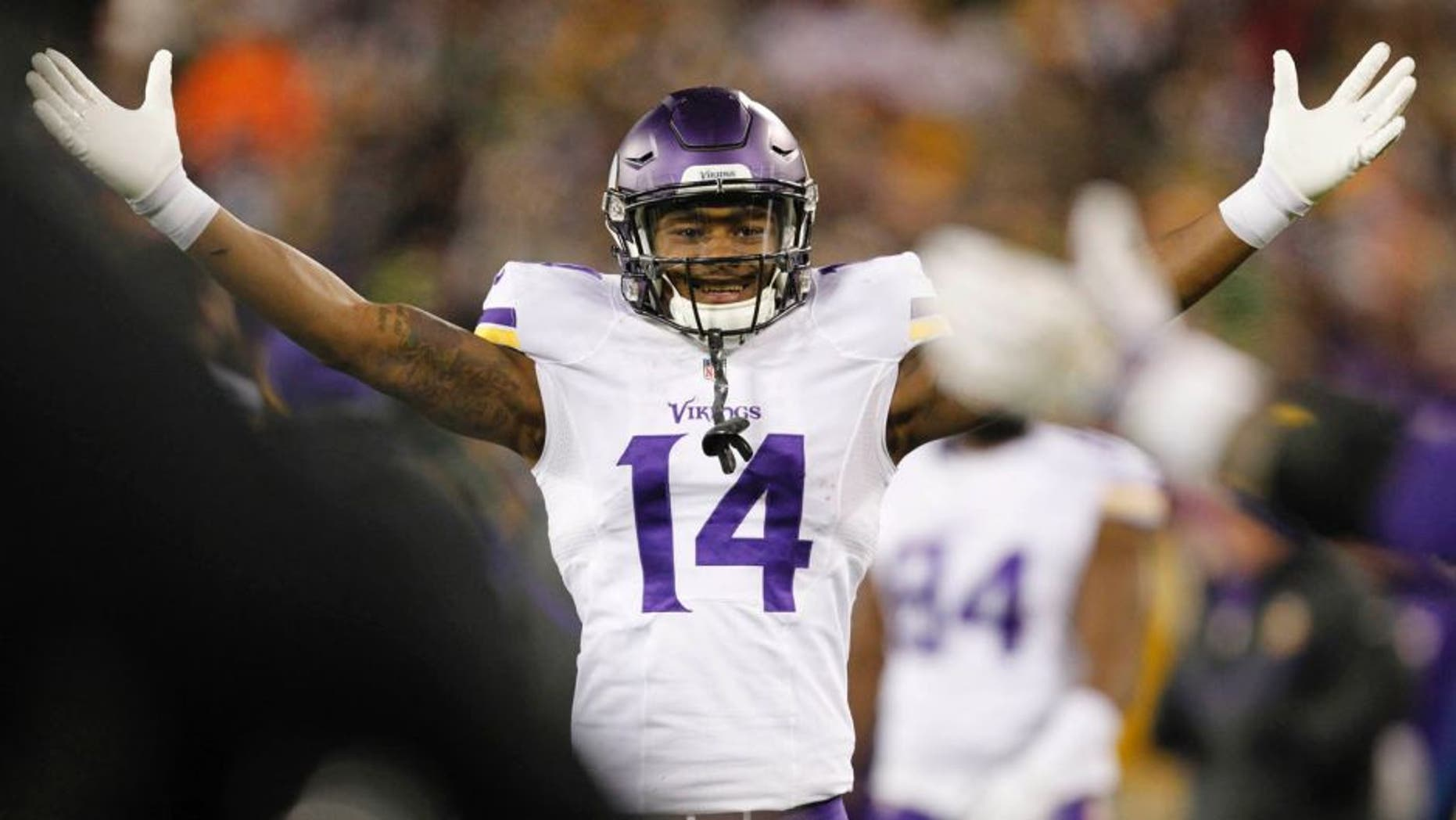 The Minnesota Vikings' Stefon Diggs celebrates during the second half against the Green Bay Packers on Sunday, Jan. 3, 2016, in Green Bay, Wis.