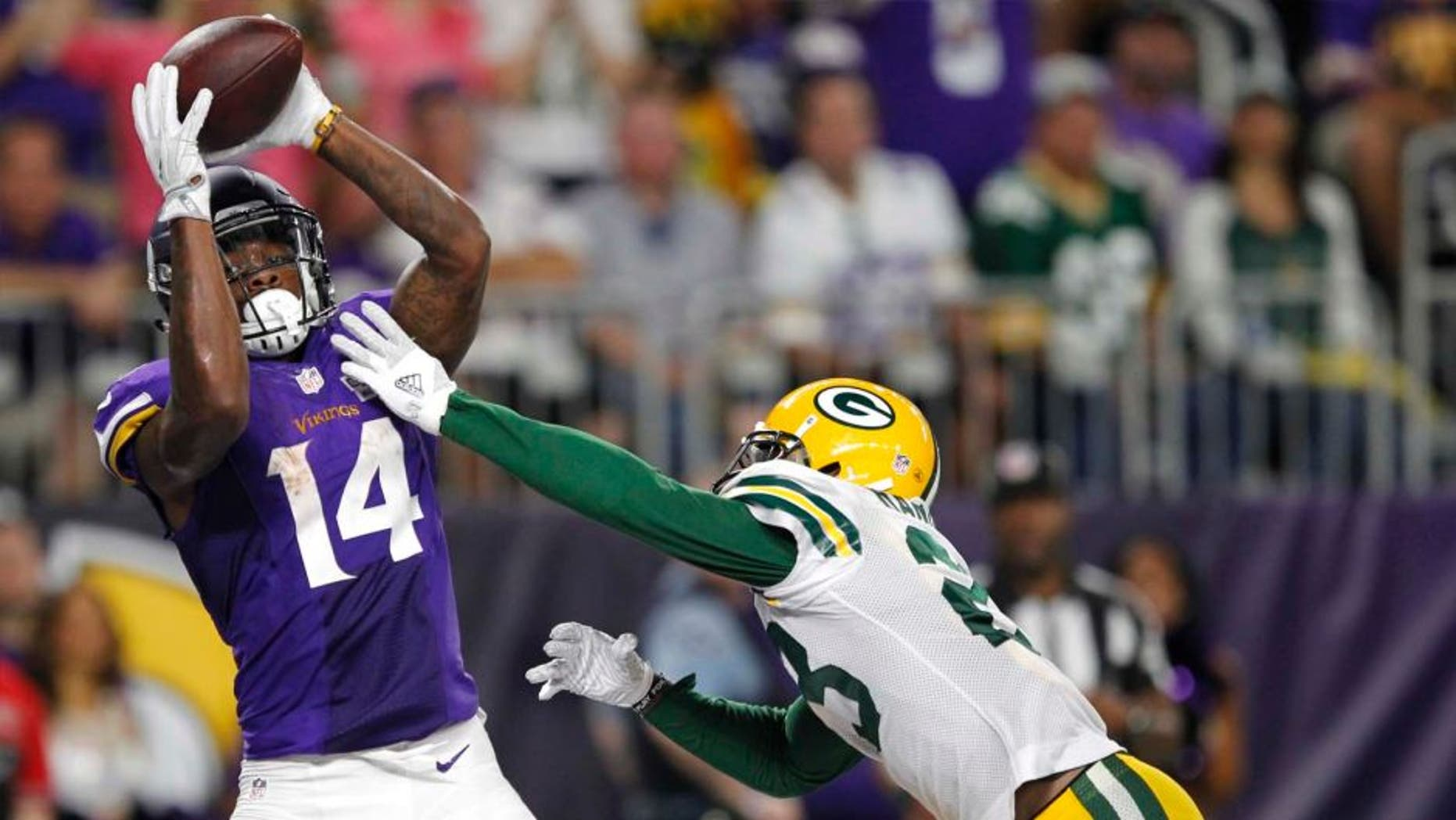 Minnesota Vikings wide receiver Stefon Diggs catches a 25-yard touchdown pass over Green Bay Packers cornerback Damarious Randall during the second half Sunday, Sept. 18, 2016, in Minneapolis.