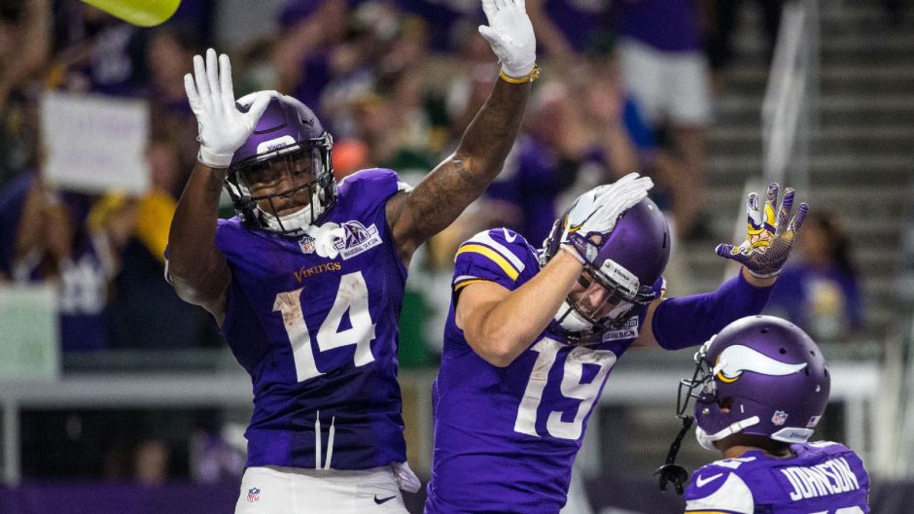 Minnesota Vikings wide receiver Stefon Diggs celebrates his touchdown with wide receiver Adam Thielen during the third quarter against the Green Bay Packers.