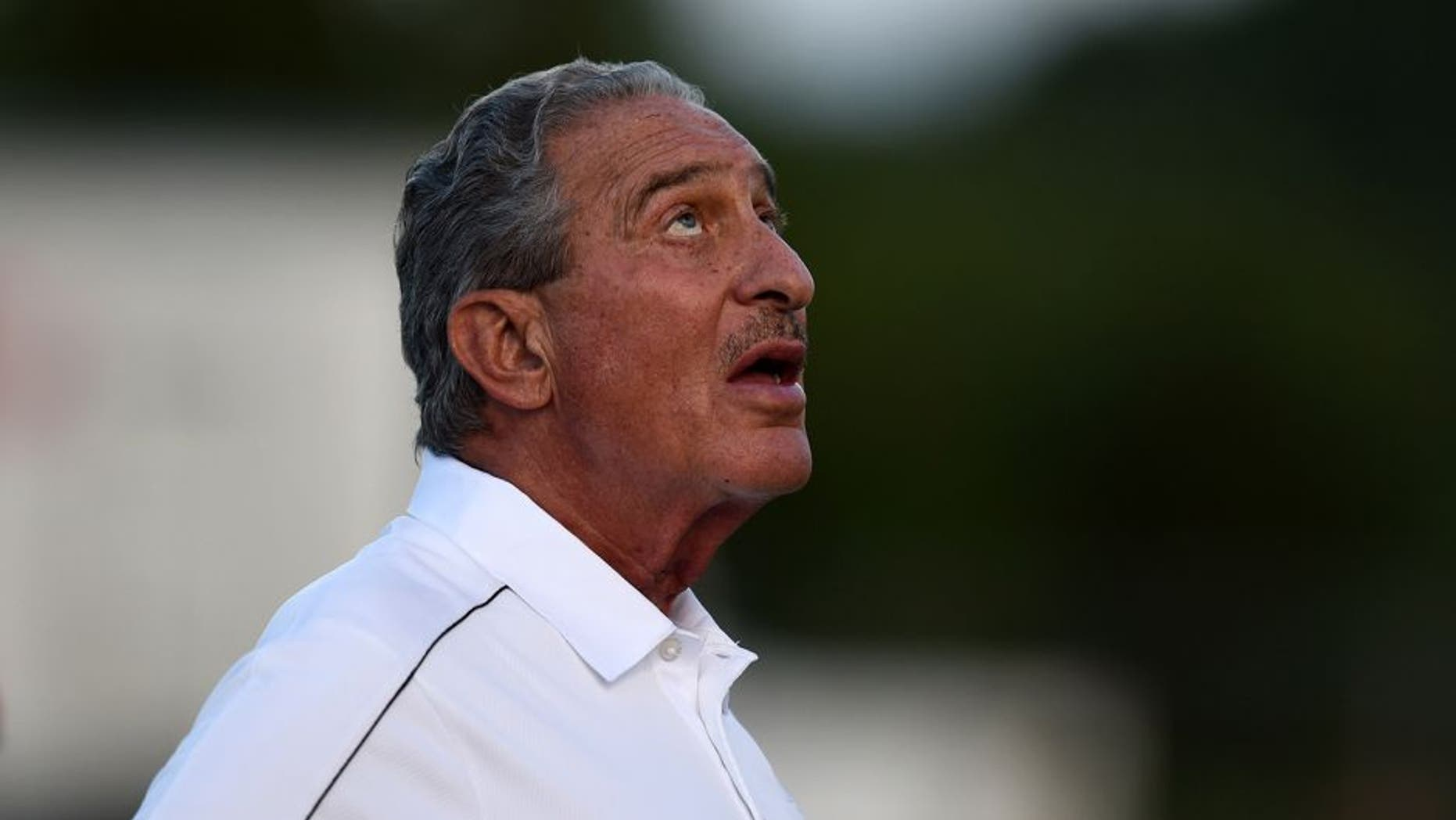 Aug 1, 2014; Lawrenceville, GA, USA; Atlanta Falcons team owner Arthur Blank watches skydivers land on the field during Atlanta Falcons practice during Falcons Friday Night Lights at Archer High School. Mandatory Credit: Dale Zanine-USA TODAY Sports