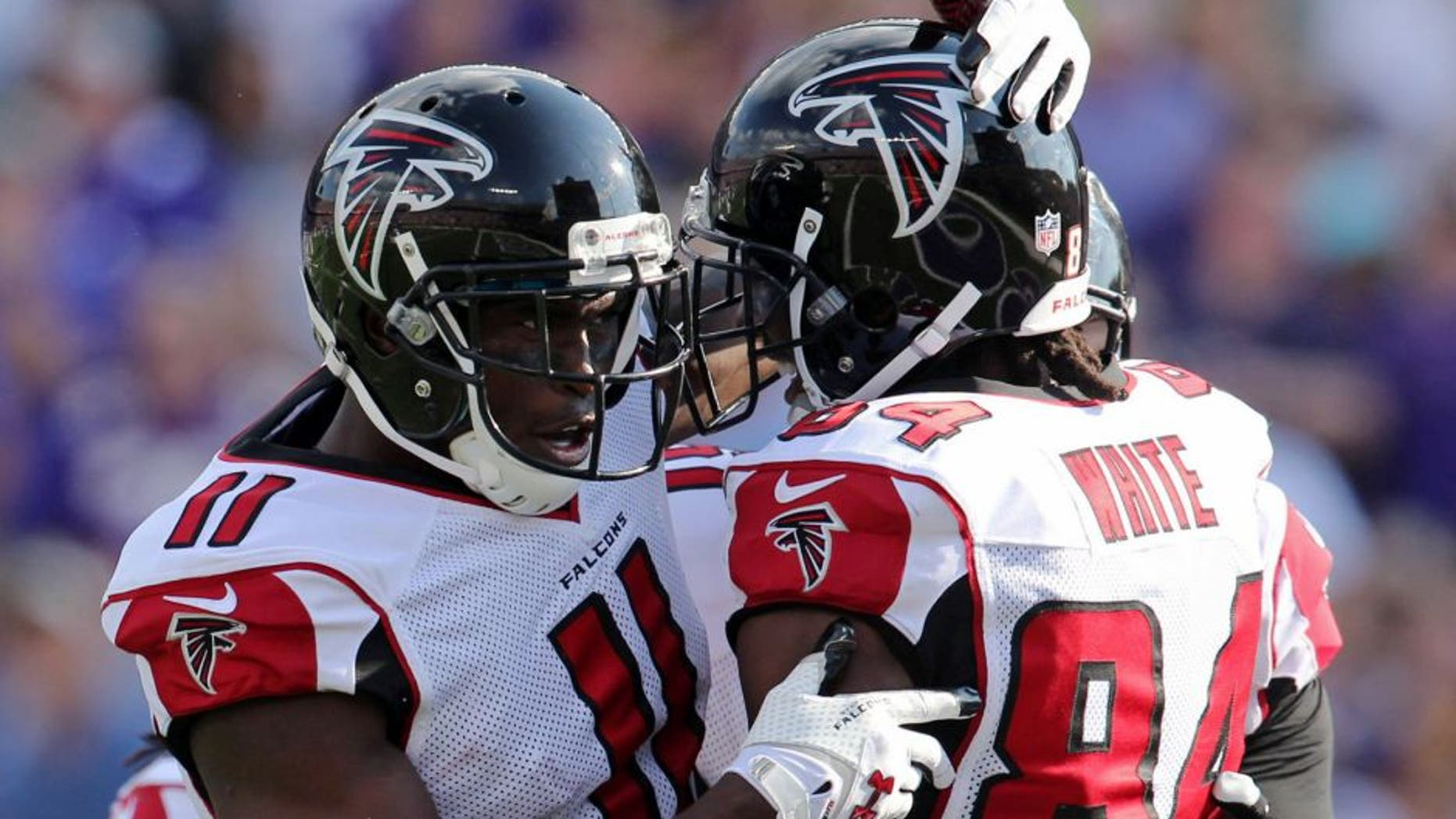 Sep 28, 2014; Minneapolis, MN, USA; Atlanta Falcons wide receiver Roddy White (84) celebrates his touchdown with wide receiver Julio Jones (11) during the first quarter against the Minnesota Vikings at TCF Bank Stadium. Mandatory Credit: Brace Hemmelgarn-USA TODAY Sports