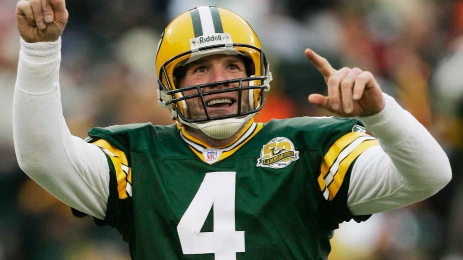 FILE - In this Dec. 9, 2007 file photo, Green Bay Packers quarterback Brett Favre reacts to a 46-yard touchdown pass to tight end Donald Lee during the second half of an NFL football game against the Oakland Raiders in Green Bay, Wis. Favre will be inducted into the team's Hall of Fame and have his jersey retired next year. Favre writes on his official website that it will be an honor to have his name placed among others such Bart Starr, Curly Lambeau, Ray Nitschke and Vince Lombardi, to name a few.
