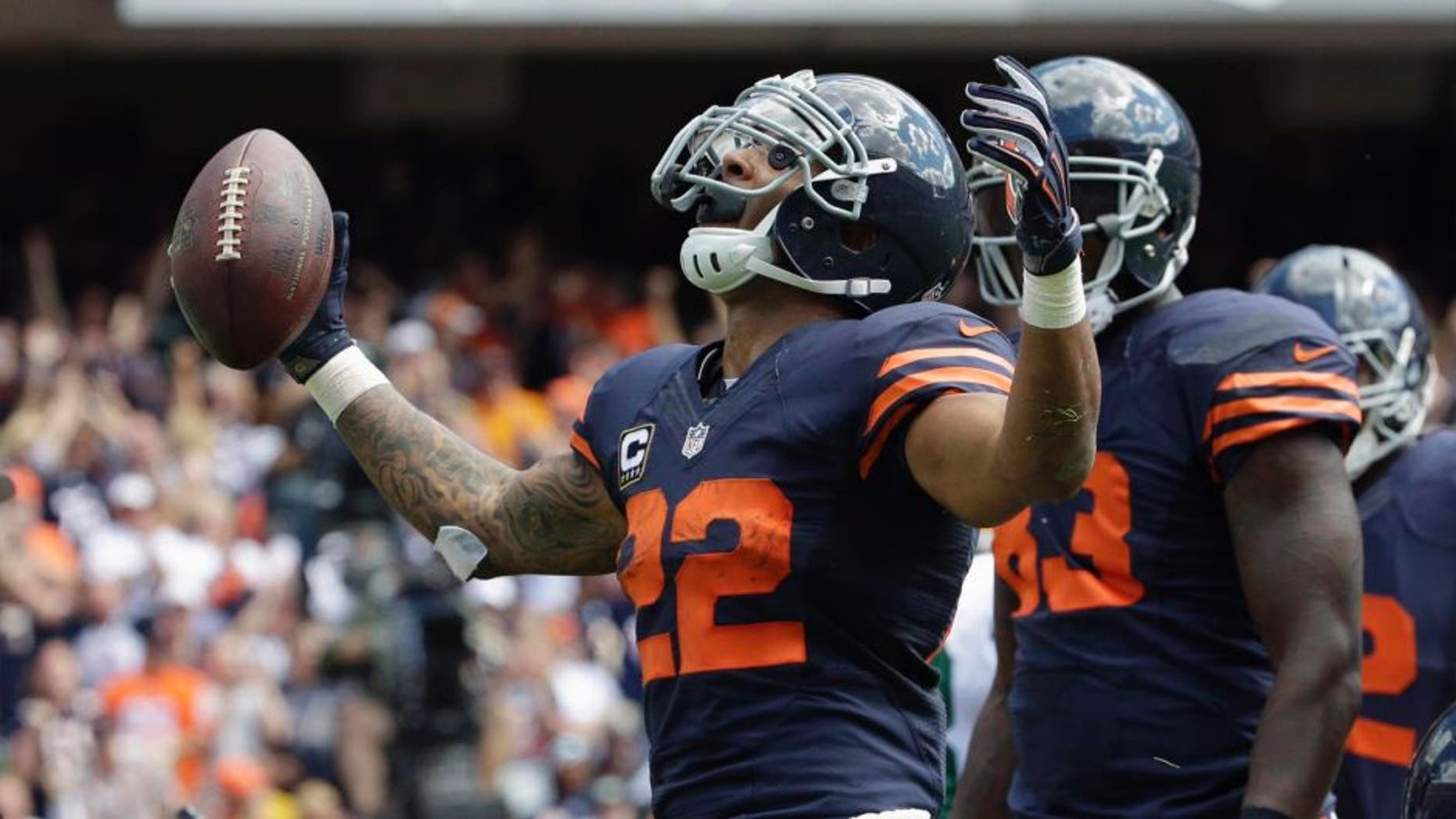 Chicago Bears running back Matt Forte celebrates a touchdown during the first half of an NFL football game against the Green Bay Packers, Sunday, Sept. 13, 2015, in Chicago.