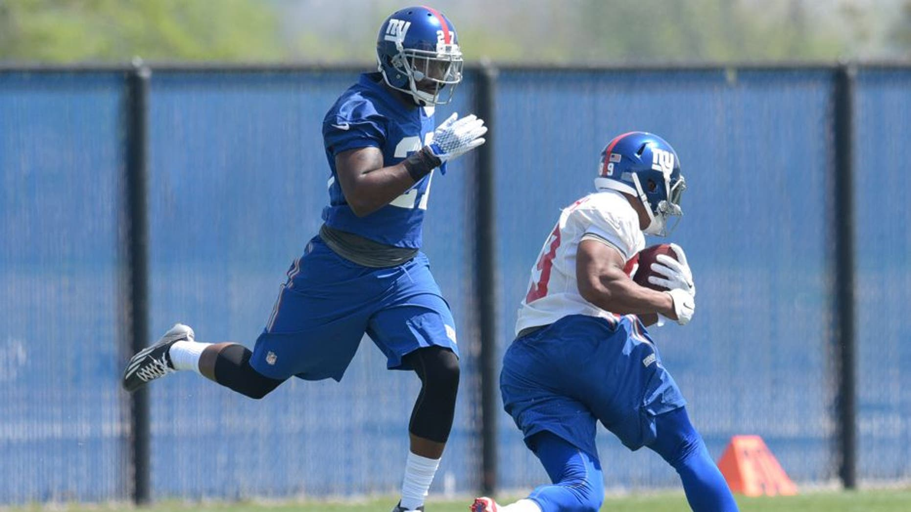 New York Giants second round draft pick Landon Collins, left, avoids a collision with Jerome Cunningham during practice at the team's NFL football rookie minicamp Friday, May 8, 2015, in East Rutherford, N.J. (AP Photo/Bill Kostroun)