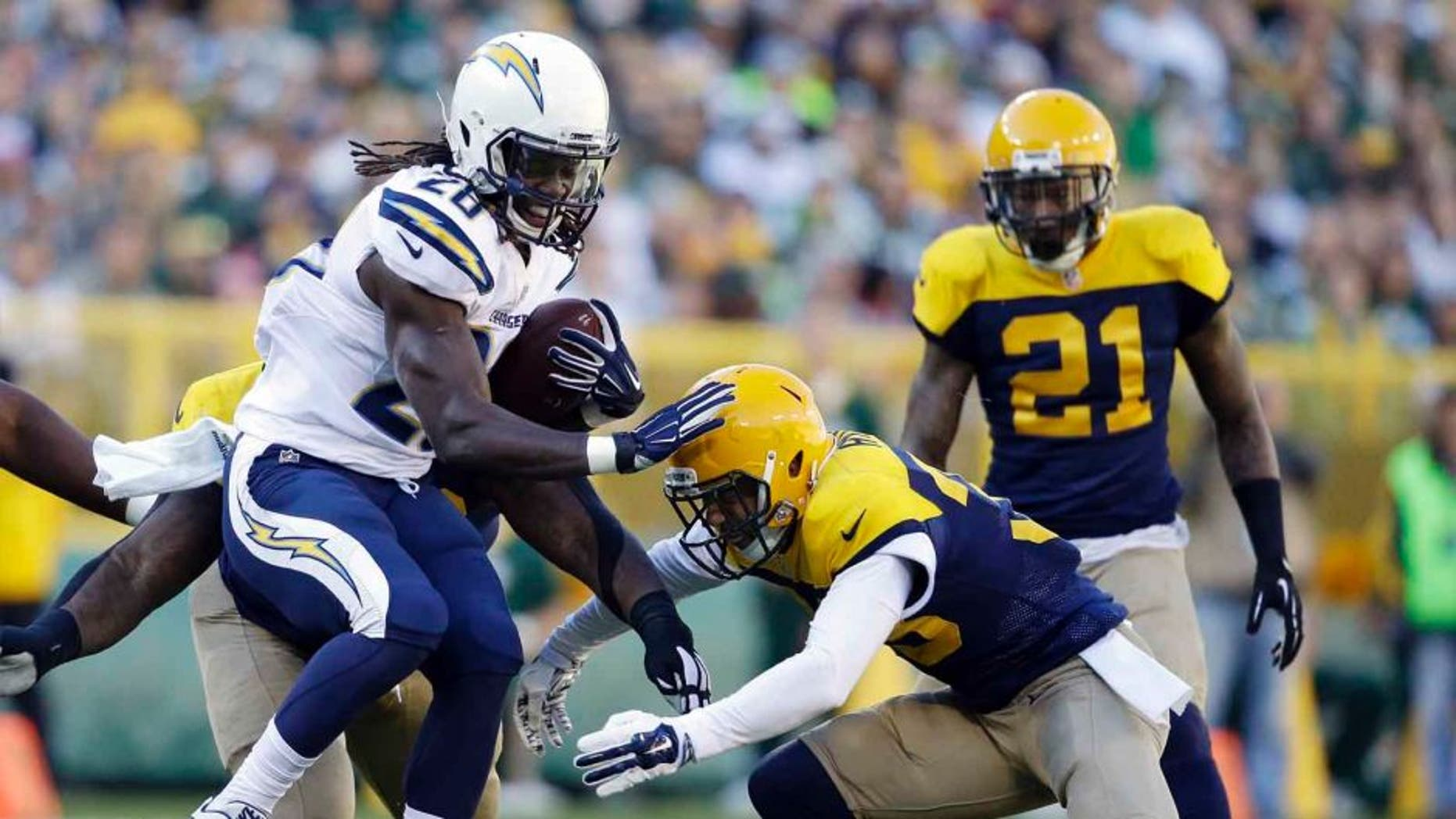 San Diego Chargers running back Melvin Gordon is tackled by the Green Bay Packers' Micah Hyde during the first half Sunday, Oct. 18, 2015, in Green Bay, Wis.