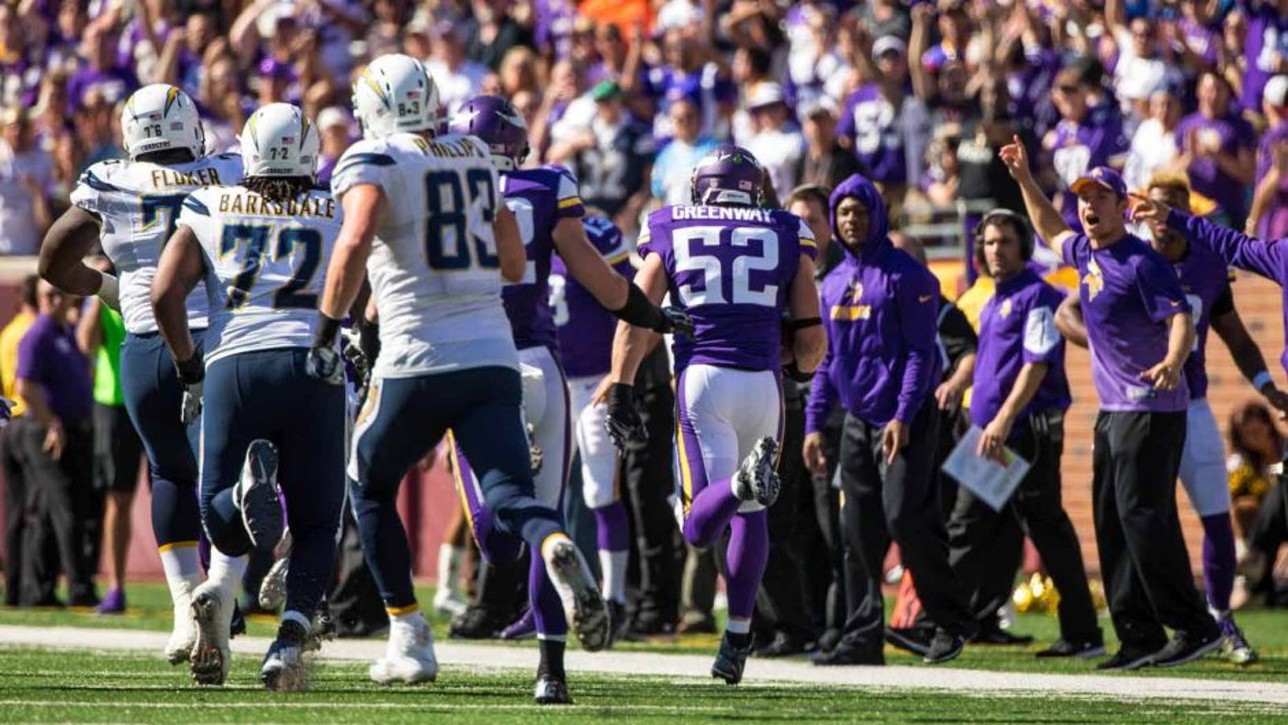 Minnesota Vikings linebacker Chad Greenway returns an interception for a touchdown during the fourth quarter against the San Diego Chargers at TCF Bank Stadium in Minneapolis on Sunday, Sept. 27, 2015. The Vikings defeated the Chargers 31-14.