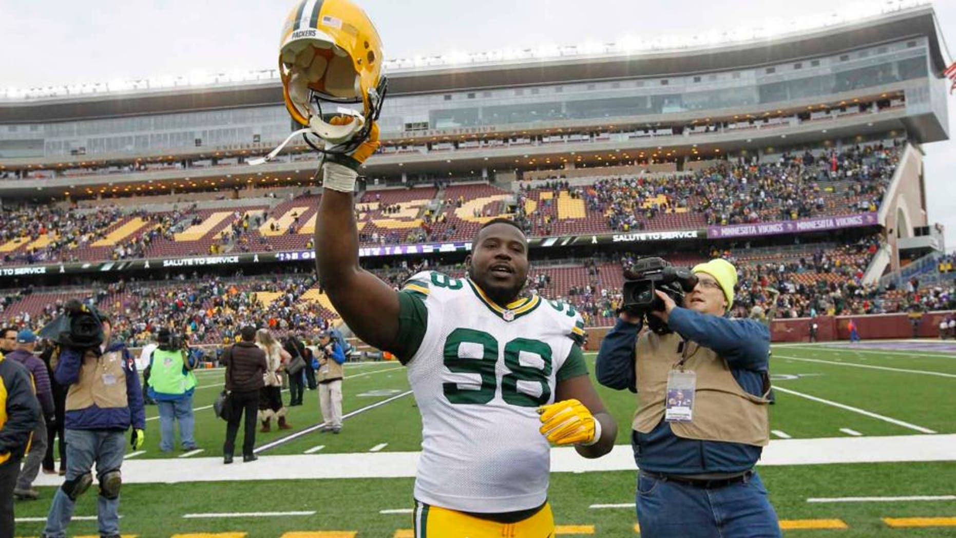 Green Bay Packers nose tackle Letroy Guion celebrates after the Packers' 24-21 win against the Minnesota Vikings in Minneapolis.