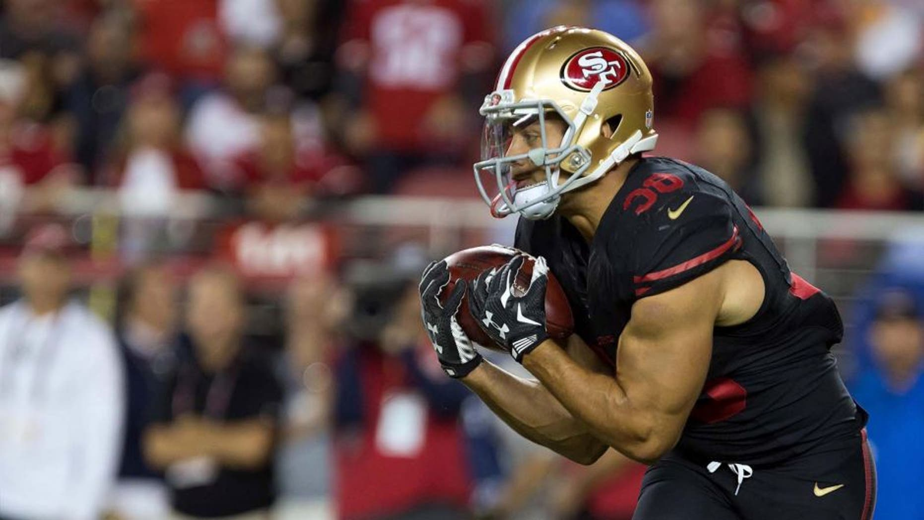 San Francisco 49ers running back Jarryd Hayne catches the ball on a punt return against the Minnesota Vikings during the second quarter at Levi's Stadium in Santa Clara, Calif., on Monday, Sept. 14, 2015.