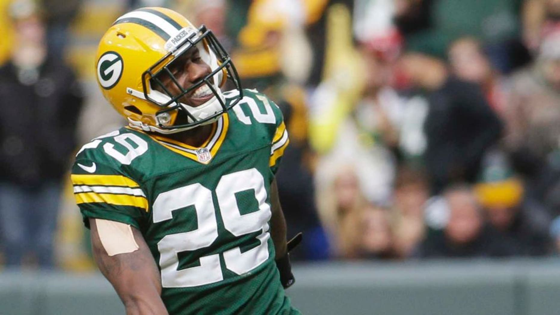 The Green Bay Packers' Casey Hayward celebrates after intercepting a pass during the second half against the Carolina Panthers.