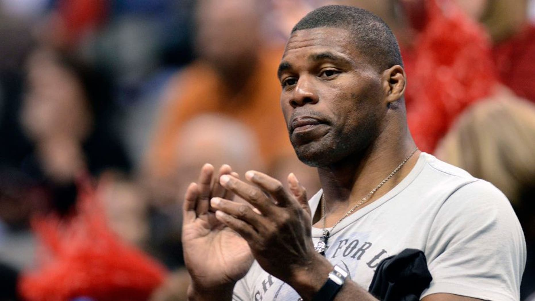 Mar 27, 2011; Dallas, TX, USA; Georgia Bulldogs former football player Herschel Walker cheers during player introductions before their game against the Texas A&M Aggies during the semifinals of the Dallas regional of the 2011 NCAA women's basketball tournament at the American Airlines Center. Mandatory Credit: Matt Strasen-USA TODAY Sports
