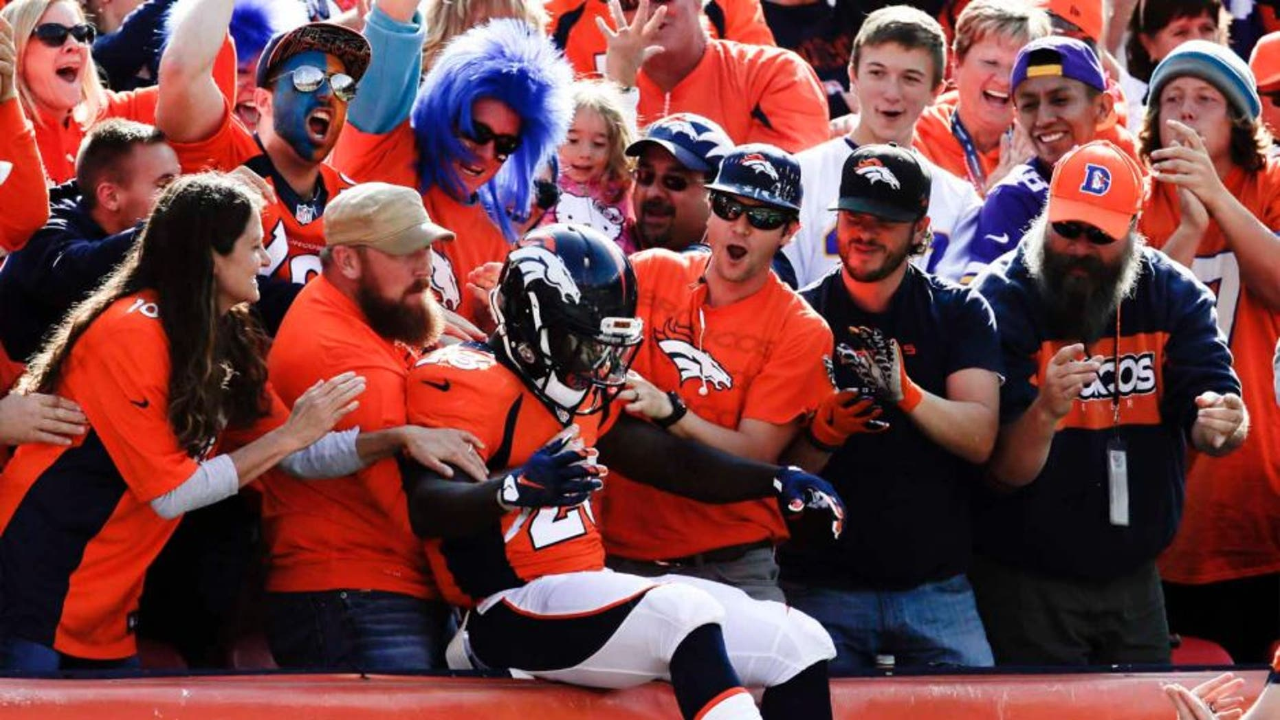 Denver Broncos running back Ronnie Hillman celebrates after scoring against the Minnesota Vikings during the first half Sunday, Oct. 4, 2015, in Denver.