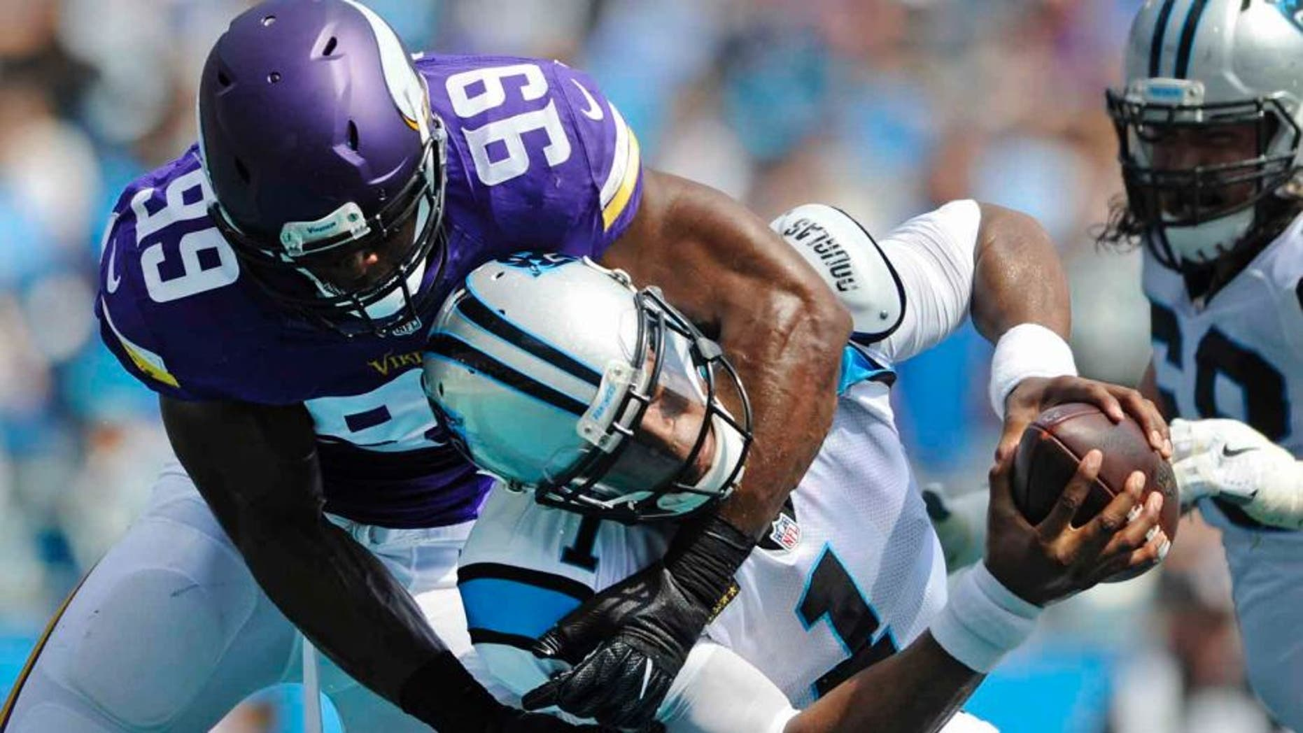 The Carolina Panthers' Cam Newton is sacked in the end zone for a safety by the Minnesota Vikings' Danielle Hunter in the first half in Charlotte, N.C., Sunday, Sept. 25, 2016.