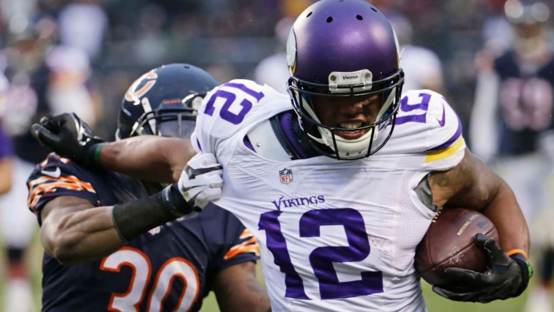 Minnesota Vikings receiver Charles Johnson (right) tries to avoid getting tackled by Chicago Bears cornerback Demontre Hurst during the second half.