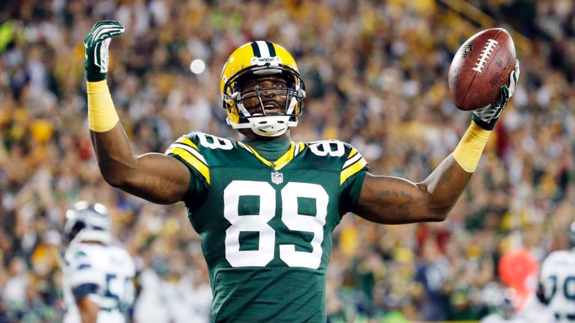 The Green Bay Packers' James Jones celebrates a touchdown catch during the first half of an NFL football game against the Seattle Seahawks on Sunday, Sept. 20, 2015, in Green Bay, Wis.