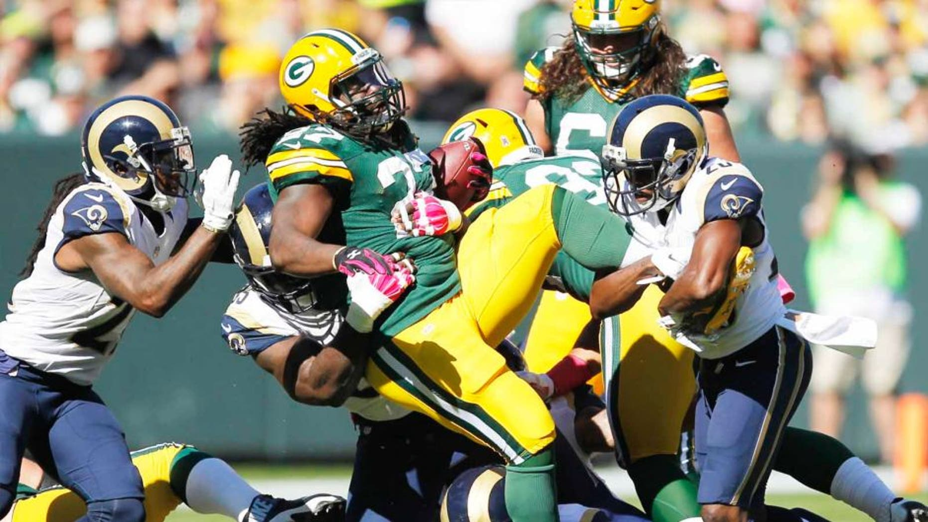 The Green Bay Packers' Eddie Lacy is stopped during the first half against the St. Louis Rams on Sunday, Oct. 11, 2015, in Green Bay, Wis.