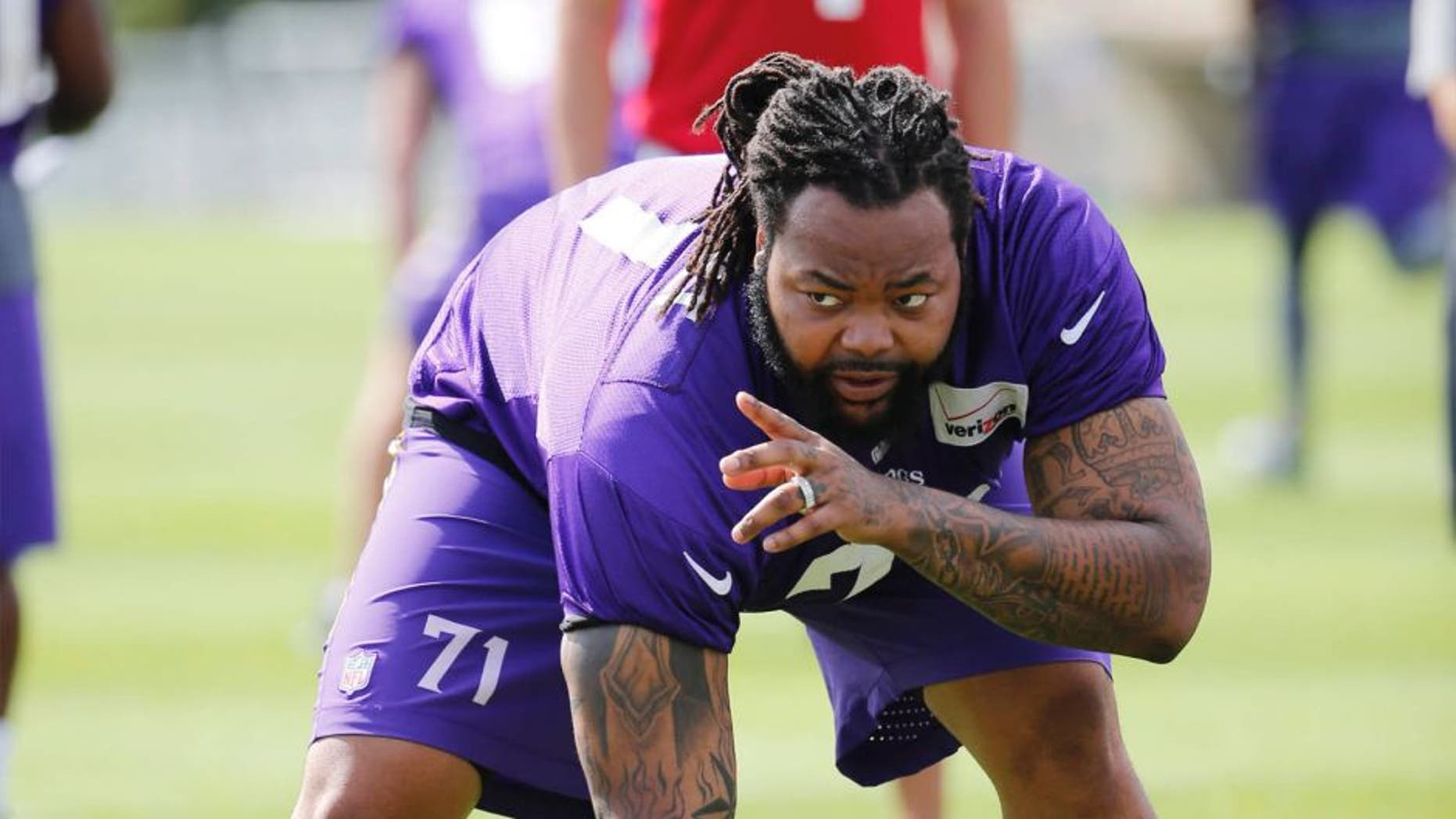 Sunday, July 26: Minnesota Vikings tackle Phil Loadholt identifies a defensive player during practice at training camp on the campus of Minnesota State University in Mankato.