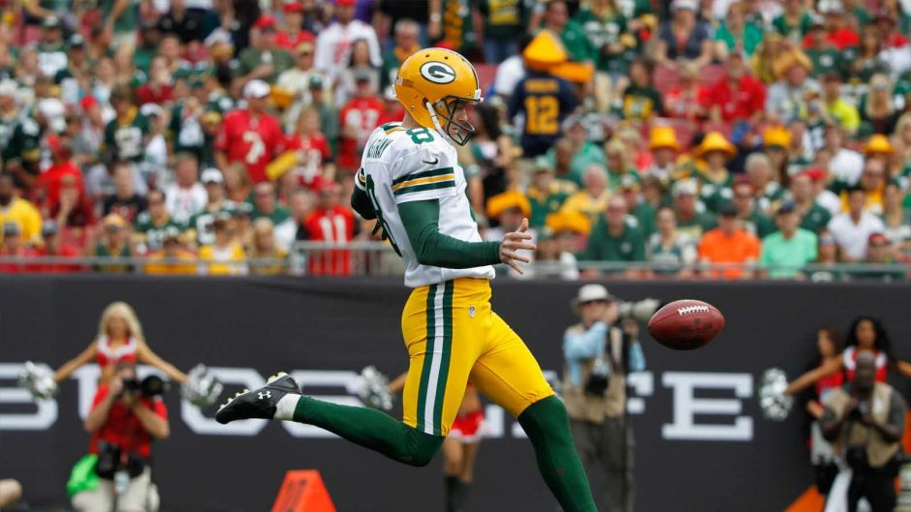 Green Bay Packers punter Tim Masthay punts the ball against the Tampa Bay Buccaneers during the first quarter at Raymond James Stadium on Dec. 21, 2014.