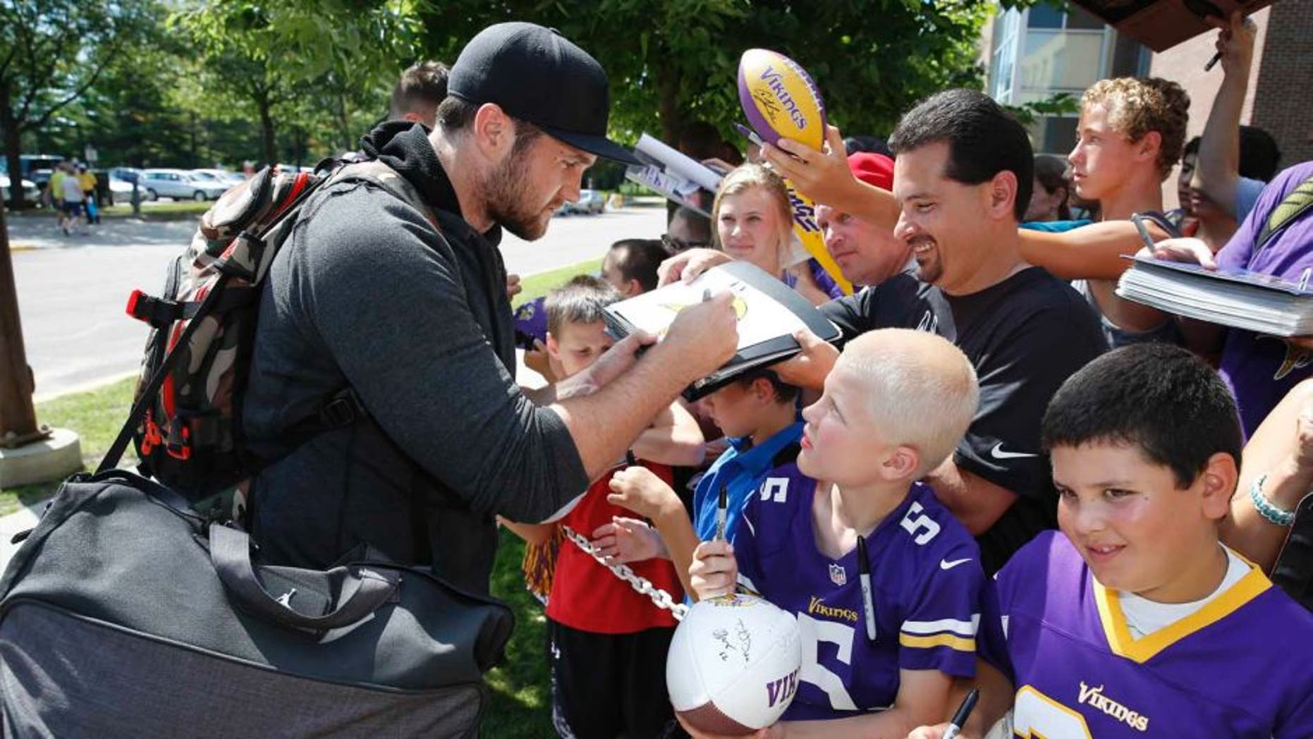 Minnesota Vikings linebacker Casey Matthews signs autographs as he reports to training camp on the campus of Minnesota State University, Saturday, July 25, 2015, in Mankato.