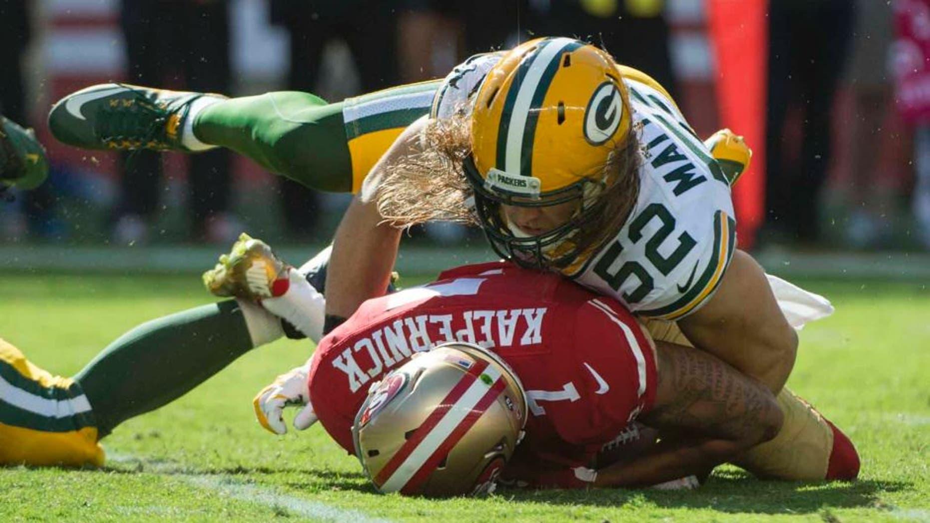 Green Bay Packers inside linebacker Clay Matthews sacks San Francisco 49ers quarterback Colin Kaepernick during the third quarter at Levi's Stadium in Santa Clara, Calif., on Sunday, Oct. 4, 2015.