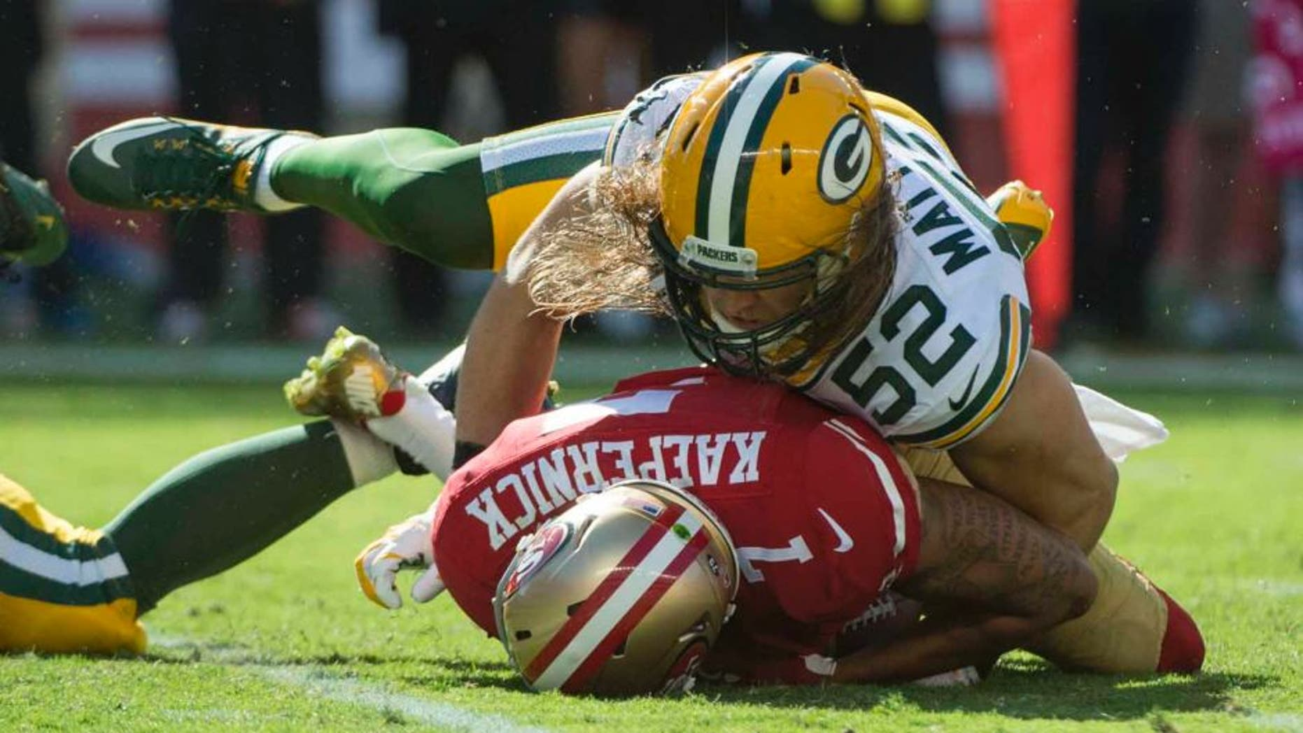 Green Bay Packers inside linebacker Clay Matthews sacks San Francisco 49ers quarterback Colin Kaepernick during the third quarter at Levi's Stadium in Santa Clara, Calif., on Sunday, Oct. 4, 2015.