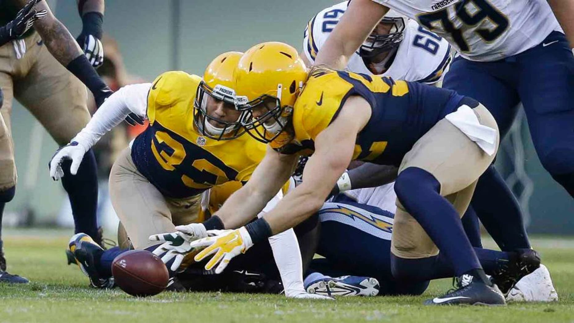 The Green Bay Packers' Clay Matthews recovers a fumble by the San Diego Chargers' Melvin Gordon during the first half Sunday, Oct. 18, 2015, in Green Bay, Wis.