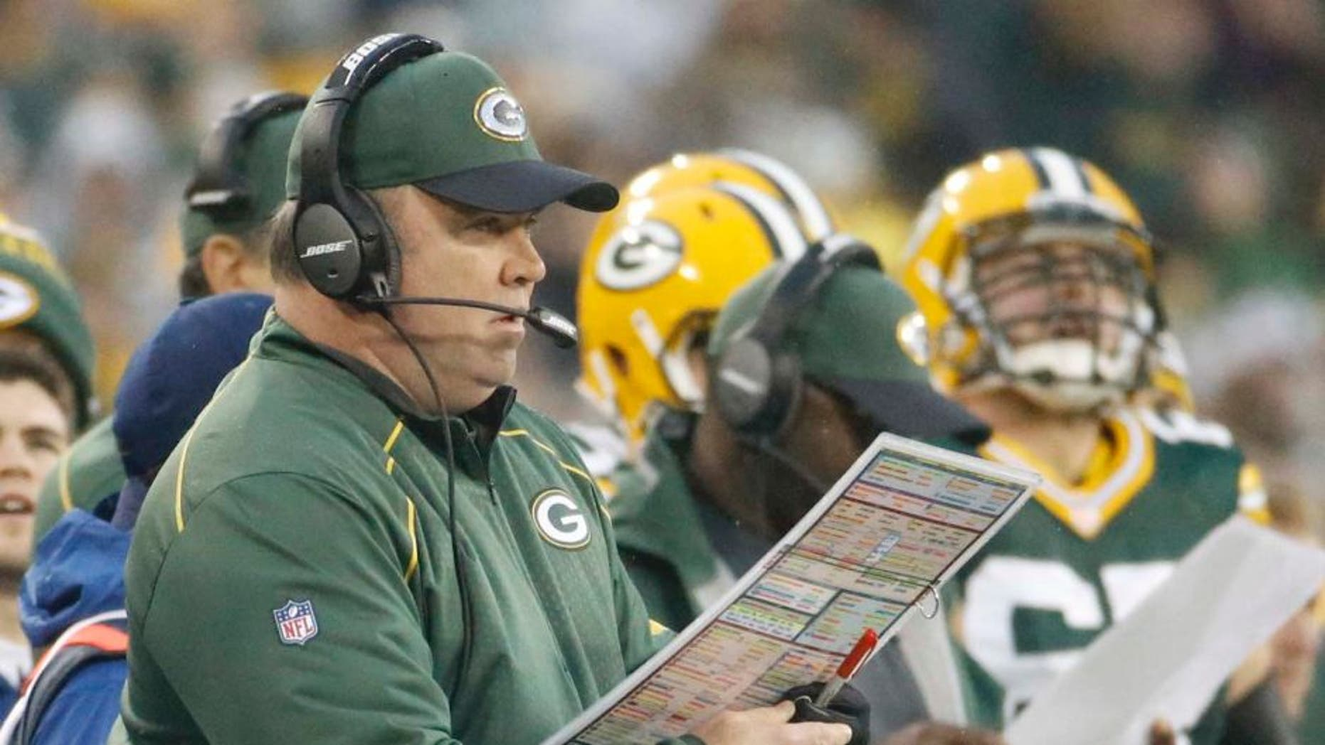 Green Bay Packers head coach Mike McCarthy calls a play during the first half against the Dallas Cowboys in Green Bay, Wis., on Sunday, Dec. 13, 2015.