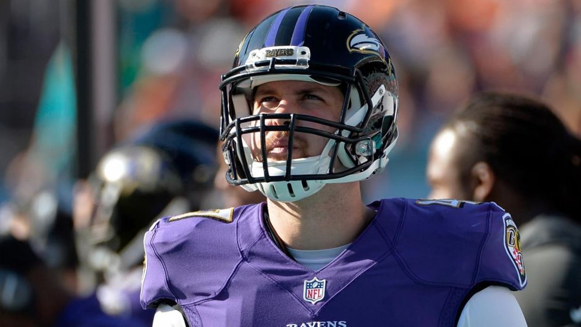 Dec 7, 2014; Miami Gardens, FL, USA; Baltimore Ravens long snapper Kevin McDermott looks on during the second half against the Miami Dolphins at Sun Life Stadium. Ravens won 28-13.