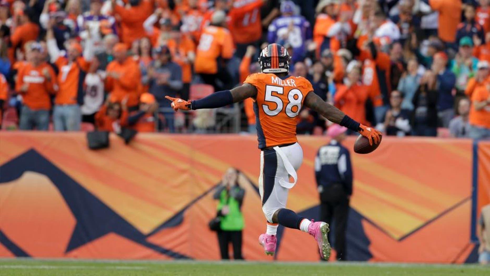 Denver Broncos outside linebacker Von Miller celebrates after sacking Minnesota Vikings quarterback Teddy Bridgewater during the second half in Denver on Sunday, Oct. 4, 2015.