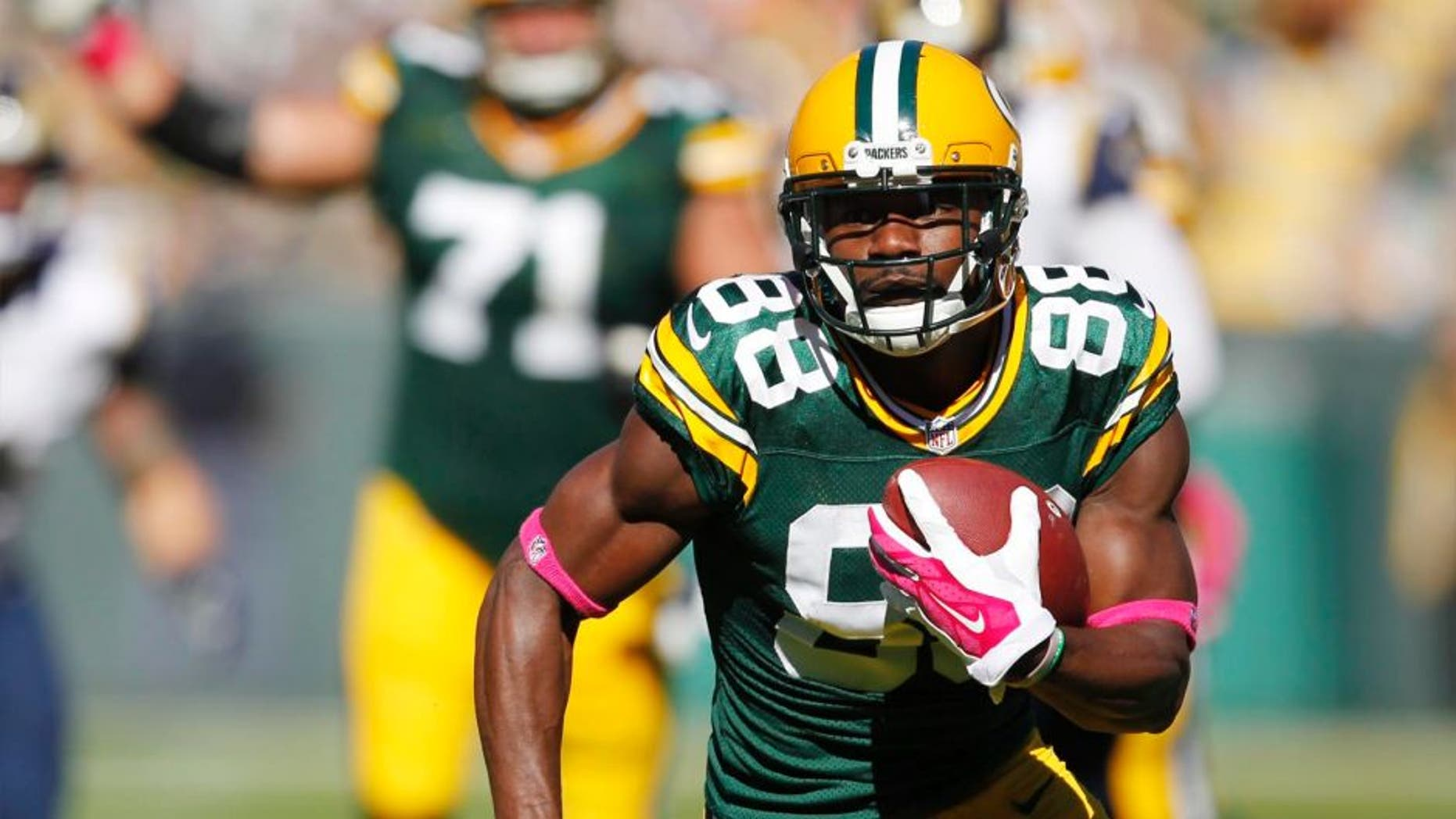 The Green Bay Packers' Ty Montgomery catches a touchdown pass during the first half against the St. Louis Rams on Sunday, Oct. 11, 2015, in Green Bay, Wis.