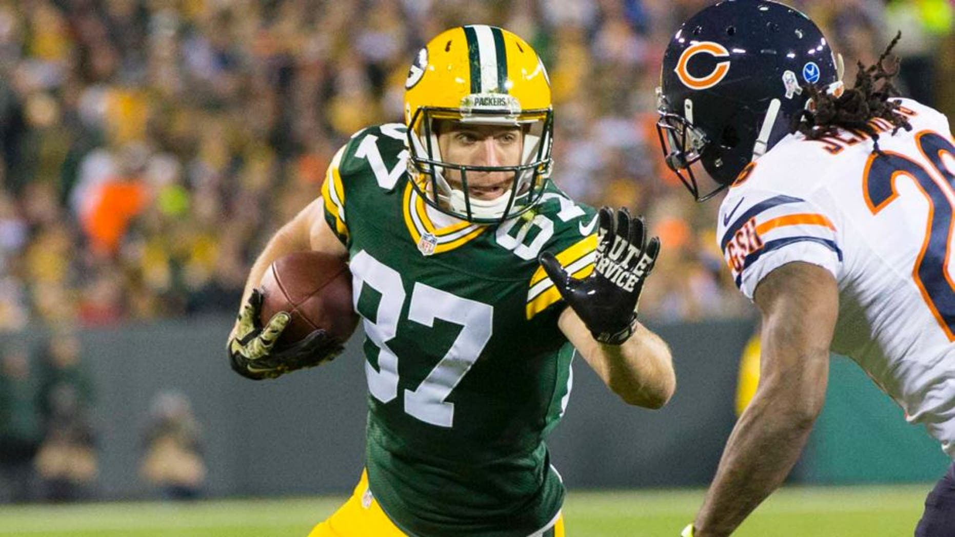 Nov 9, 2014; Green Bay, WI, USA; Green Bay Packers wide receiver Jordy Nelson (87) prepares to stiff arm Chicago Bears cornerback Tim Jennings (26) after catching a pass during the first quarter at Lambeau Field. Mandatory Credit: Jeff Hanisch-USA TODAY Sports