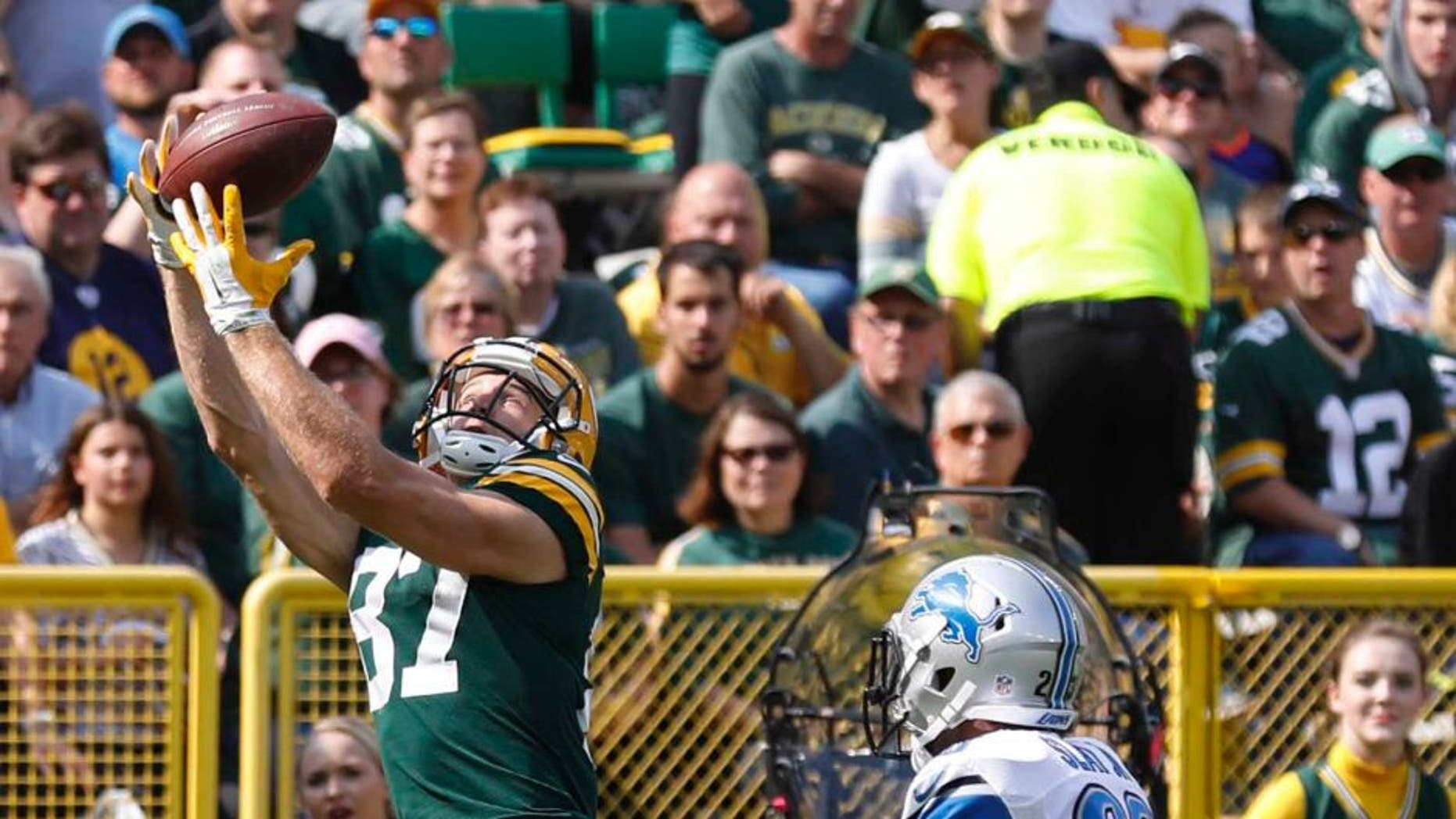 The Green Bay Packers' Jordy Nelson catches a touchdown pass in front of the Detroit Lions' Darius Slay during the first half Sunday, Sept. 25, 2016, in Green Bay, Wis.