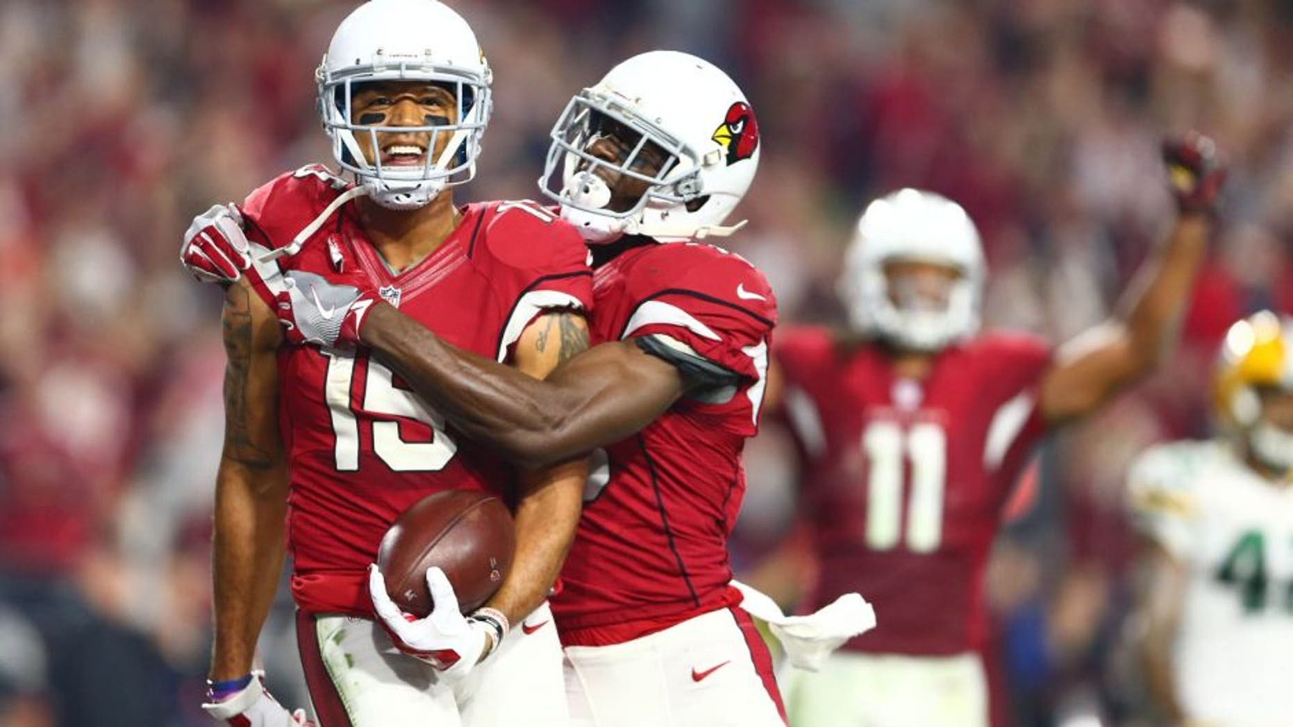 Jan 16, 2016; Glendale, AZ, USA; Arizona Cardinals wide receiver Michael Floyd (15) celebrates with wide receiver Jaron Brown (13) after catching a pass for a touchdown against the Green Bay Packers during the fourth quarter in a NFC Divisional round playoff game at University of Phoenix Stadium. Mandatory Credit: Mark J. Rebilas-USA TODAY Sports