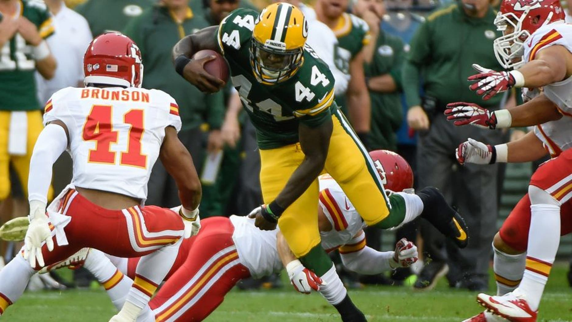 Aug 28, 2014; Green Bay, WI, USA; Green Bay Packers running back James Starks (44) runs with the ball as Kansas City Chiefs defensive back Malcolm Bronson (41) chases in the first quarter at Lambeau Field. Mandatory Credit: Benny Sieu-USA TODAY Sports