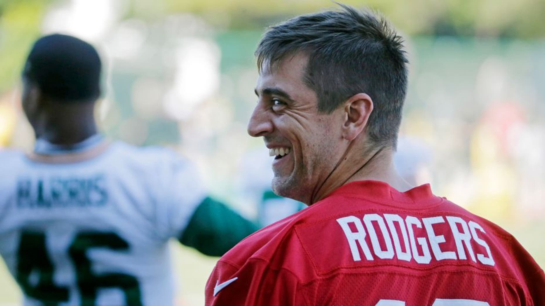 Green Bay Packers' Aaron Rodgers smiles during NFL football minicamp, Tuesday, June 16, 2015, in Green Bay, Wis. (AP Photo/Morry Gash)