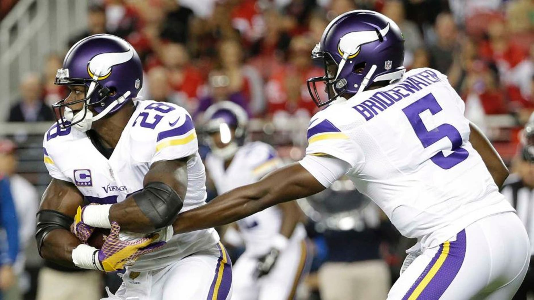 Minnesota Vikings running back Adrian Peterson takes a hand off from quarterback Teddy Bridgewater during the first half of an NFL football game against the San Francisco 49ers in Santa Clara, Calif., Monday, Sept. 14, 2015.