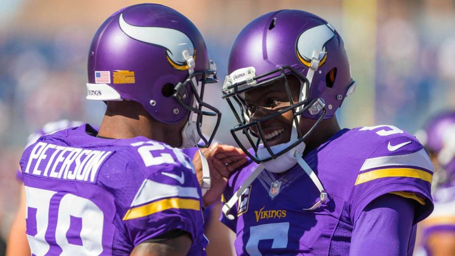 Minnesota Vikings quarterback Teddy Bridgewater and running back Adrian Peterson smile before the game the San Diego Chargers at TCF Bank Stadium in Minneapolis on Sunday, Sept. 27, 2015.
