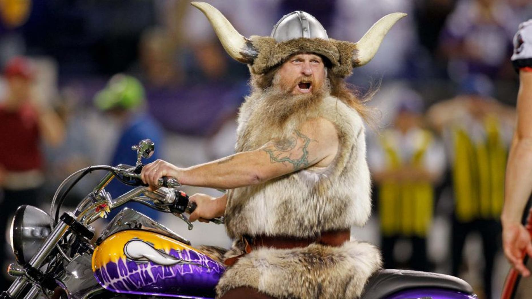 Oct 25, 2012; Minneapolis, MN, USA; Minnesota Vikings mascot Ragnar yells at a player from the Tampa Bay Buccaneers as he goes onto the field and leads the Vikings before the game at the Metrodome. The Buccaneers win 36-17. Mandatory Credit: Bruce Kluckhohn-USA TODAY Sports