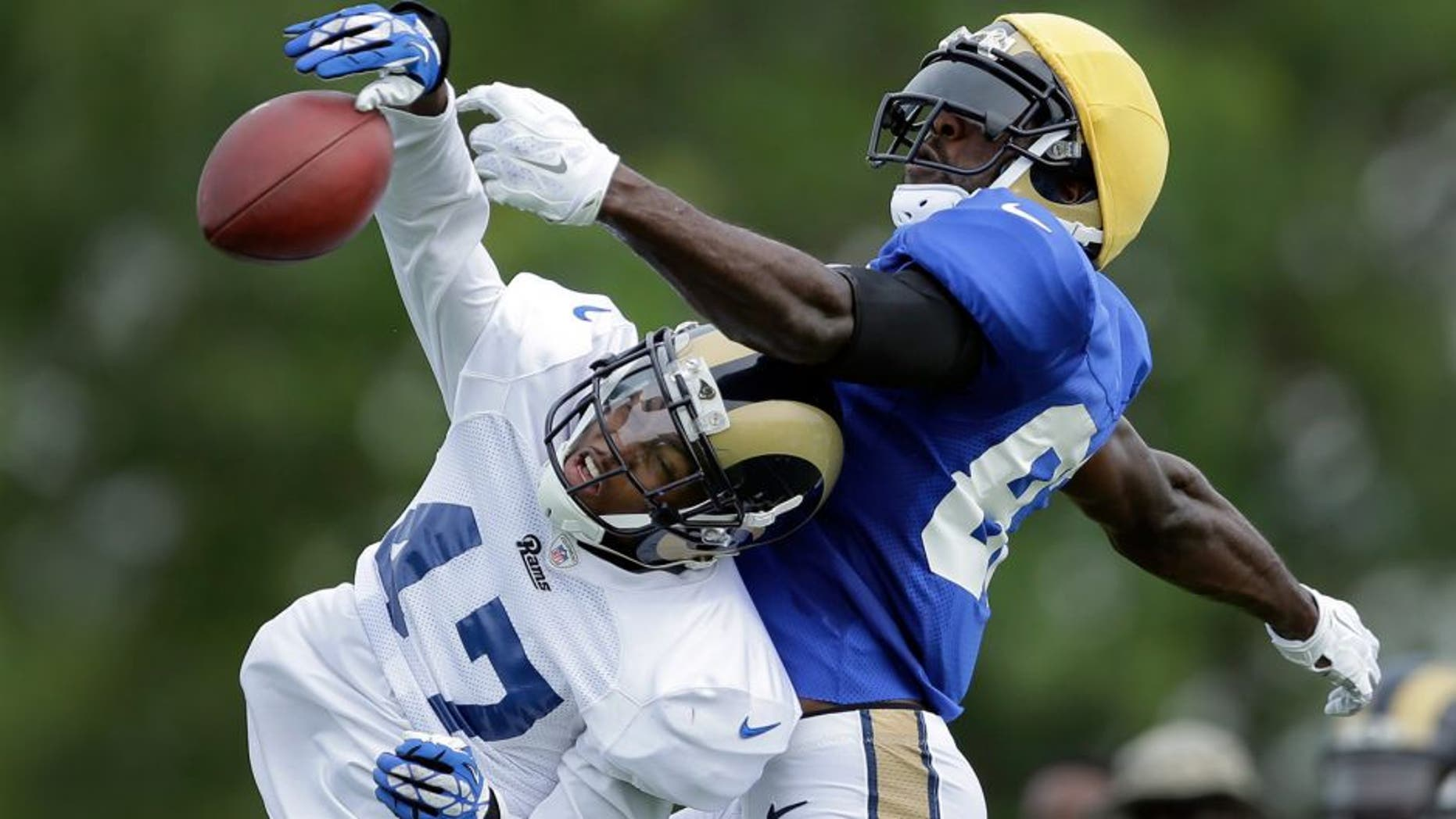 St. Louis Rams cornerback Marcus Roberson, left, knocks a pass away from wide receiver Brian Quick during training camp at the NFL football team's practice facility Tuesday, Aug. 4, 2015, in St. Louis. (AP Photo/Jeff Roberson)