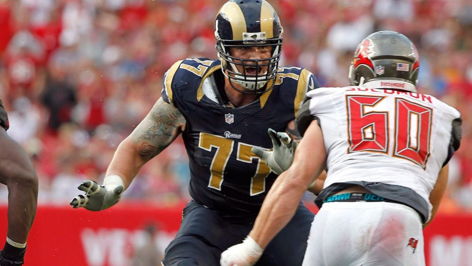 Sep 14, 2014; Tampa, FL, USA; St. Louis Rams tackle Jake Long (77) blocks against the Tampa Bay Buccaneers during the second half at Raymond James Stadium. St. Louis Rams defeated the Tampa Bay Buccaneers 19-17. Mandatory Credit: Kim Klement-USA TODAY Sports