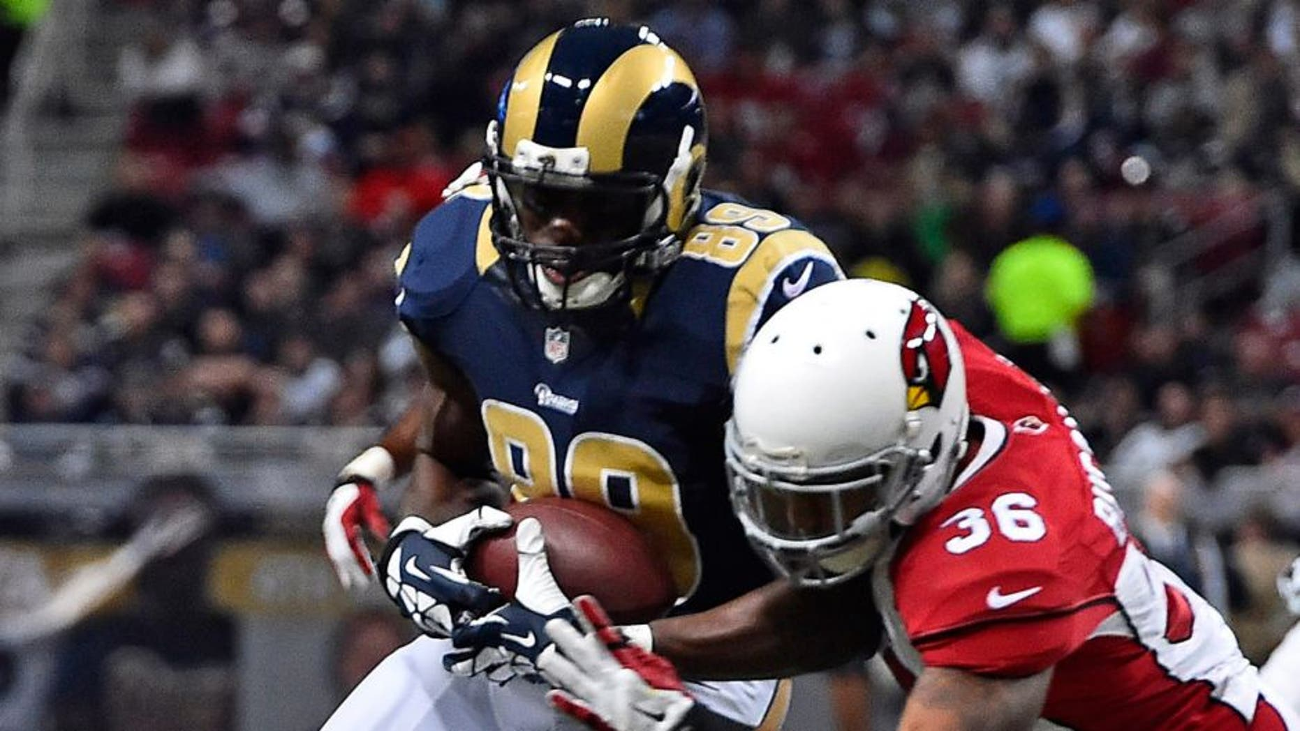 Dec 11, 2014; St. Louis, MO, USA; Arizona Cardinals strong safety Deone Bucannon (36) brings down St. Louis Rams tight end Jared Cook (89) during the first half at the Edward Jones Dome. Mandatory Credit: Jasen Vinlove-USA TODAY Sports