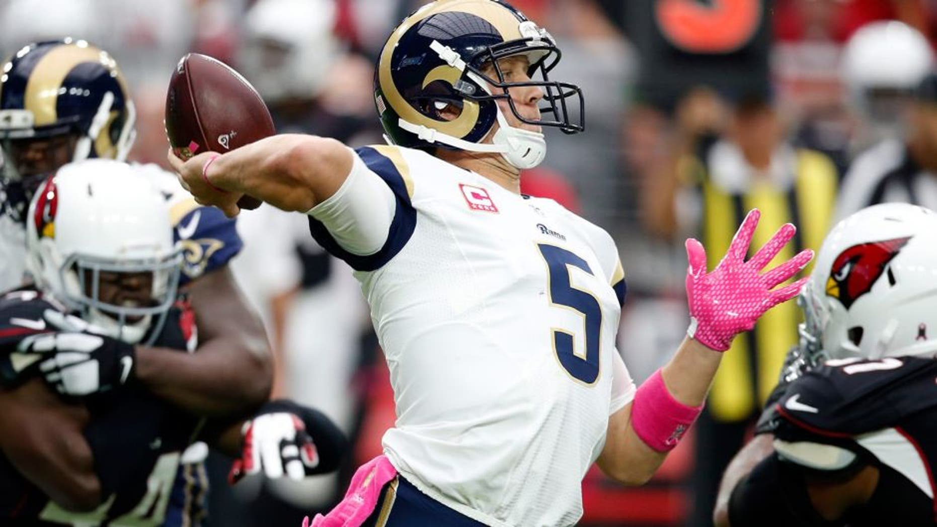 St. Louis Rams quarterback Nick Foles (5) throws against the Arizona Cardinals during the first half of an NFL football game, Sunday, Oct. 4, 2015, in Glendale, Ariz. (AP Photo/Ross D. Franklin)