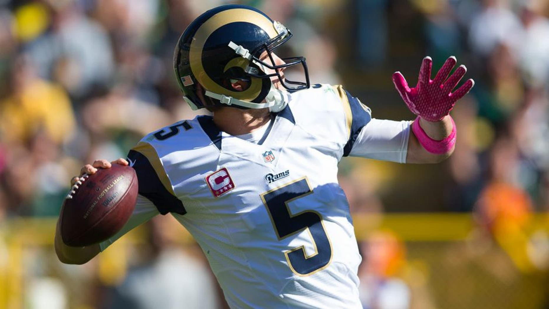 Oct 11, 2015; Green Bay, WI, USA; St. Louis Rams quarterback Nick Foles (5) throws a pass during the second quarter against the Green Bay Packers at Lambeau Field. Mandatory Credit: Jeff Hanisch-USA TODAY Sports