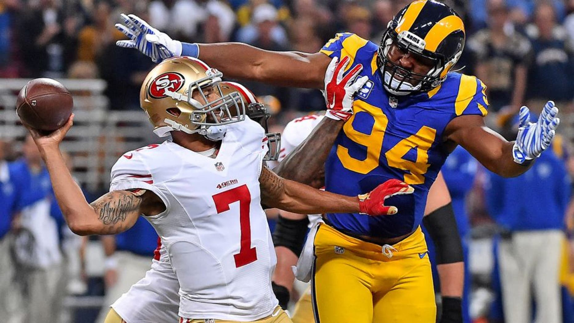 Nov 1, 2015; St. Louis, MO, USA; St. Louis Rams defensive end Robert Quinn (94) pressures San Francisco 49ers quarterback Colin Kaepernick (7) during the first half at the Edward Jones Dome. Mandatory Credit: Jasen Vinlove-USA TODAY Sports